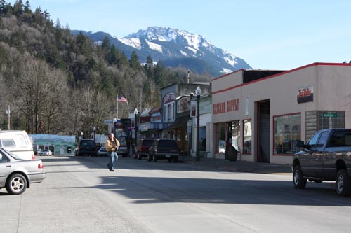 "With Sauk Mountain as a backdrop, Concrete's Main Street town center bustles during the summer tourist season. With State Route 20 closing at Ross Lake each winter, and the recent closure of the overnight camping area at Rockport State Park 10 miles to the east, however, the off-season months make economic viability a daunting challenge for area businesses. ""I see the Concrete Herald as something every eastern Skagit County business can rally around, and not just in terms of advertising dollars,"" said Jason Miller, the Concrete writer and editor who has launched a fundraising drive to bring back the town's newspaper."