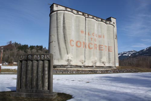 "Conjoined monoliths, a row of massive cement silos greets visitors to Concrete. Remnants of Concrete's cement-manufacturing past, the iconic silos made an appearance in the 1993 film ""This Boy's Life,"" based on the memoirs of writer and literature professor Tobias Wolff."