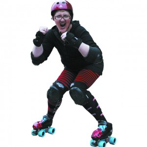 "Concrete dentist Sharon Feller, a.k.a. ""Fill-us Driller,"" is ready to take on the competition as a Skagit Valley Roller Girl."