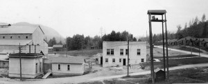 This circa 1926 photo shows the east facade of the Superior Portland Cement Company Office and Laboratory Building and the original timeclock room. Constructed in 1923, the administrative building got a basement addition in 1928. In 1932 the safety monument was erected in front, facing Main Street. (Photo courtesy of Cal Portland.)