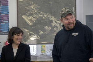 "U.S. Rep. Suzan DelBene shares a laugh with former Concrete Mayor Judd Wilson during a Jan. 6 ceremony at Concrete Town Hall. DelBene, Senator Kirk Pearson, and Dept. of Commerce Dir. Brian Bonlender were in town to deliver a $1 million ""check"" to help fund a new Fire and Life Safety Building. The building was one of Wilson's top priorities during his term; he made three trips to Olympia with Fire Chief Rich Philips to discuss the project's urgency with Pearson, who worked to secure a $785,000 appropriation in the State Capital budget for the project. (Photo by Denise DuVarney.)"