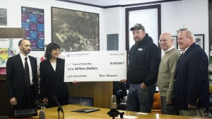 Former Concrete mayor Judd Wilson (center) holds a $1 million novelty check with Congresswoman Suzan DelBene during a Jan. 6 ceremony announcing the town's winning a Community Development Block Grant. Paired with a $785,000 State Capital Budget appropriation, the CDBG check represents complete funding for the town's Fire and Life Safety Building, one of Wilson's priorities while in office. From left, Dept. of Commerce Dir. Brian Bonlender, DelBene, Wilson, Concrete Mayor Jason Miller, and Senator Kirk Pearson. (Photo by Denise DuVarney.)